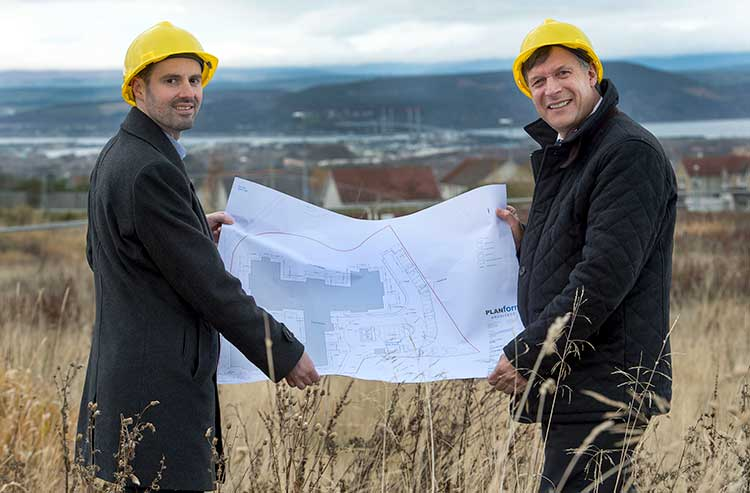 Keith Barclay (left) and Ron Taylor with the plans for Parklands' proposed Inverness development