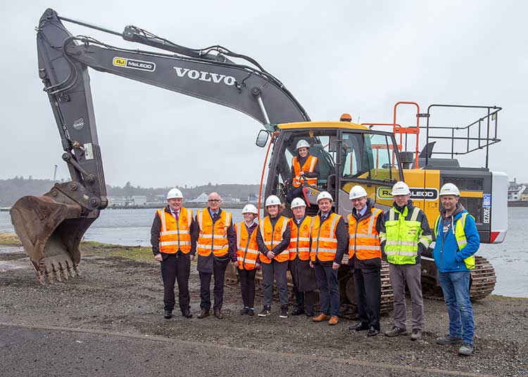 Finance Minister Kate Forbes starts the turf cutting for the Newton Marina with (left to right) HIE board member Angus Campbell; Comhairle nan Eilean Siar Leader Roddie Mackay; Izzy Marshall and Charlie MacLeod, from Stornoway Sailing Club; ex port authority chairman and former Stornoway Provost Sandy Matheson; Donald Crichton, chair of the Comhairle's Sustainable Development Committee; Stornoway Port Authority Chairman Murdo Murray; and Kevin Smith and Barry MacPhail from RJ McLeod
